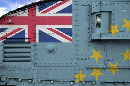 Tuvalu flag depicted on side part of military armored tank close up. Army forces conceptual background Фото со стока