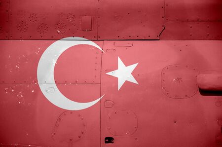 Turkey flag depicted on side part of military armored helicopter close up. Army forces aircraft conceptual background