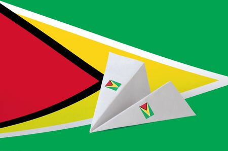 Guyana flag depicted on paper origami airplane. Oriental handmade arts concept
