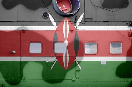 Kenya flag depicted on side part of military armored helicopter close up. Army forces aircraft conceptual background