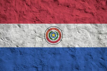 Paraguay flag depicted in bright paint colors on old relief plastering wall close up. Textured banner on rough background Фото со стока