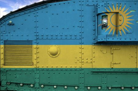 Rwanda flag depicted on side part of military armored tank close up. Army forces conceptual background