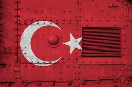 Turkey flag depicted on side part of military armored tank close up. Army forces conceptual background