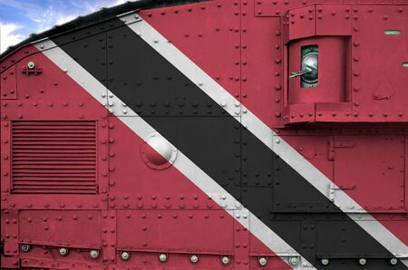 Trinidad and Tobago flag depicted on side part of military armored tank close up. Army forces conceptual background