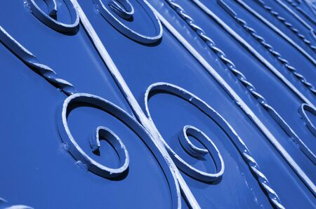 Metal texture of a piece of phantom classic blue wall with a forged pattern.