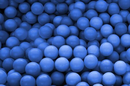 Colored plastic balls in pool of game room. Swimming pool for fun and jumping in colored plastic balls. phantom classic blue color