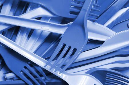 Pile of phantom classic blue color used plastic kitchenware appliances. Ecological problem. Plastic pollution Фото со стока