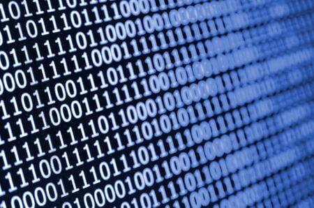 Macro shot of binary code on the monitor of an office computer. The concept of the programmers work. The flow of digital information strings. phantom classic blue color.