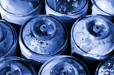 A lot of used phantom classic blue color metal tanks with paint for drawing graffiti.