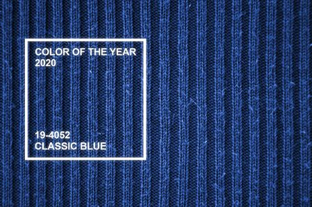 Fabric texture. Cloth knitted, cotton, wool background. Close-up of knitted fabric material. Phantom classic blue color tone