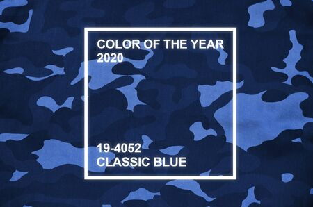 Texture of fabric with a camouflage. Army background image. Textile pattern of military camouflage fabric. Phantom classic blue color tone