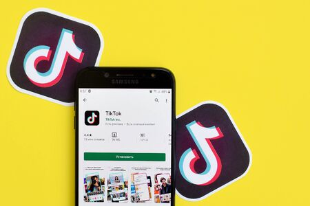 NY, USA - DECEMBER 5, 2019: Tiktok application in playmarket on samsung smartphone screen on yellow background. TikTok is a popular video-sharing social networking service owned by ByteDance