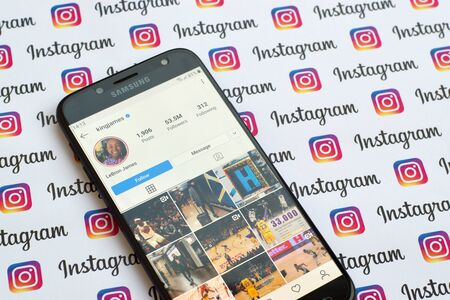 NY, USA - DECEMBER 4, 2019: LeBron James official instagram account on smartphone screen on paper instagram banner.