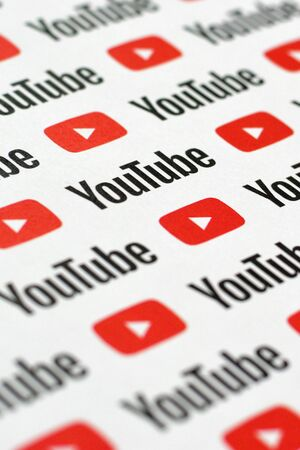 NY, USA - DECEMBER 5, 2019: Youtube pattern printed on paper with small youtube logos and inscriptions. YouTube is Google subsidiary and American most popular video-sharing platform