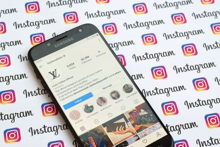 NY, USA - DECEMBER 4, 2019: Louis Vuitton official instagram account on smartphone screen on paper instagram banner.