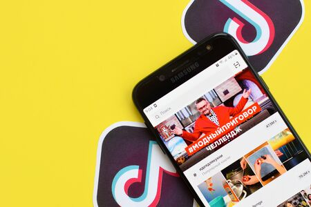 NY, USA - DECEMBER 5, 2019: Tiktok application on samsung smartphone screen on yellow background. TikTok is a popular video-sharing social networking service owned by ByteDance