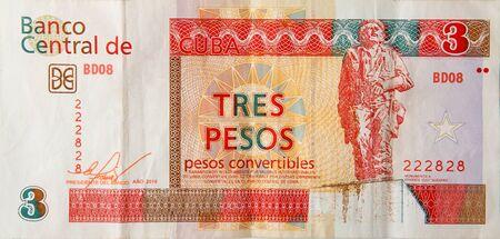 Che Guevara monument on cuban banknote of orange three pesos convertibles 2016 year Stock Photo