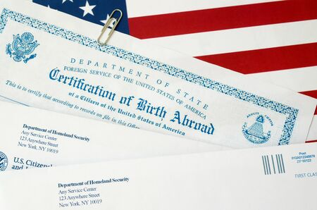 Fs-545 Certification of birth abroad lies on United States flag with envelope from Department of Homeland Security close up