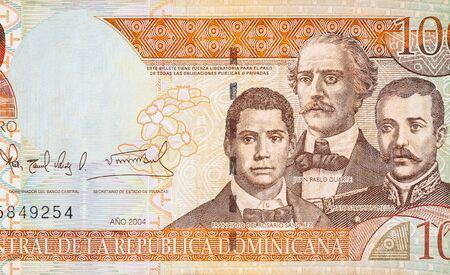 Francisco Del Rosario Sanchez portrait with Matias Ramon Mella and Juan Pablo Duarte depicted on old one hundred peso note Dominican republic money. Front side orange bill Banco de Imagens