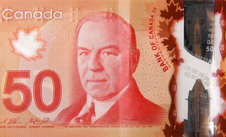 William Lyon Mackenzie King portrait on Canada 50 Dollars 2012 Polymer Banknote fragment close up