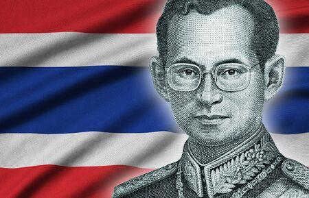 Portrait of King Bhumibol Adulyadej from 50 Baht Thailand money bill close up on Thailand flag background