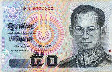 King Bhumibol Adulyadej on fragment of 50 Baht Thailand money bill close up. Bill of national currency of Thailand. 2004 版權商用圖片