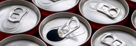 Many aluminium soda drink cans close up. Advertising for Soda drinks or tin cans mass manufacturing