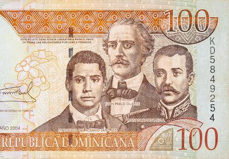 Francisco Del Rosario Sanchez portrait with Matias Ramon Mella and Juan Pablo Duarte depicted on old one hundred peso note Dominican republic money. Front side orange bill 写真素材
