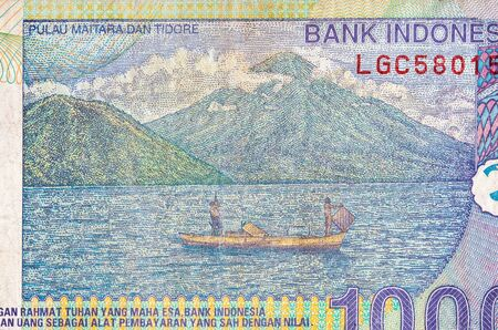 Pulau Maitara Dan Tidore on Indonesia 1000 rupiah bank note, former currency of Indonesia. Colored bill close up fragment
