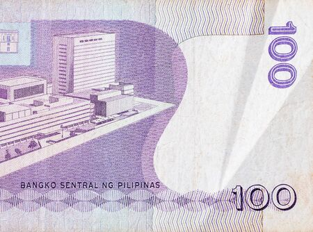 Philippines central bank on 100 piso Philippines money bill close up fragment. Bill of national currency of Philippines