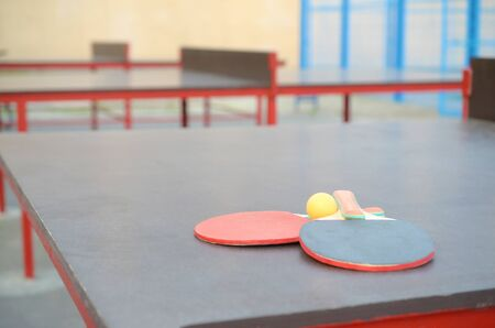 rackets and ball close up on table in outdoor sport yard. Active sports and physical training concept