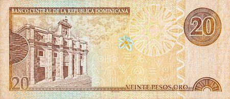 Panteon Nacional building depicted on old twenty peso note Dominican republic money. Rear side orange bill Фото со стока