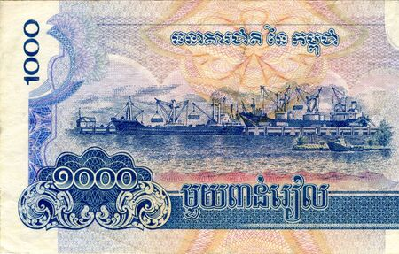 Fragment of 1000 Cambodian riels banknote is national currency of Cambodia. Side of money bill close up