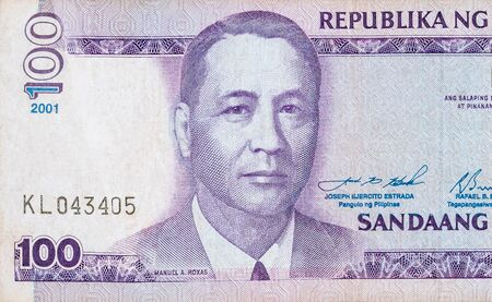 Manuel A Roxas on 100 piso Philippines money bill close up fragment. Bill of national currency of Philippines 写真素材