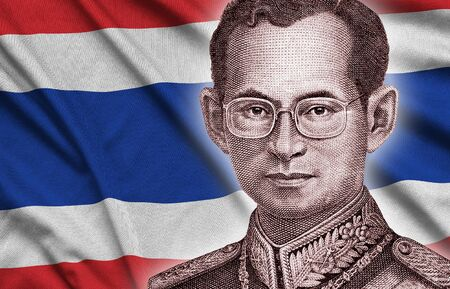 Portrait of King Bhumibol Adulyadej from 50 Baht Thailand money bill close up on Thailand flag background