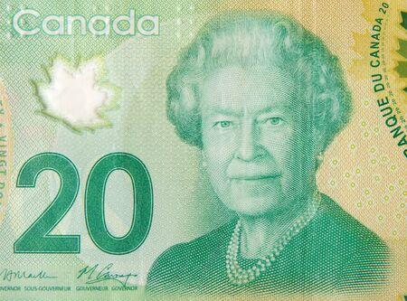 Ihre Majestät Königin Elizabeth II Portrait aus Kanada 20 Dollar 2012 Polymer Banknote Fragment Nahaufnahme Standard-Bild