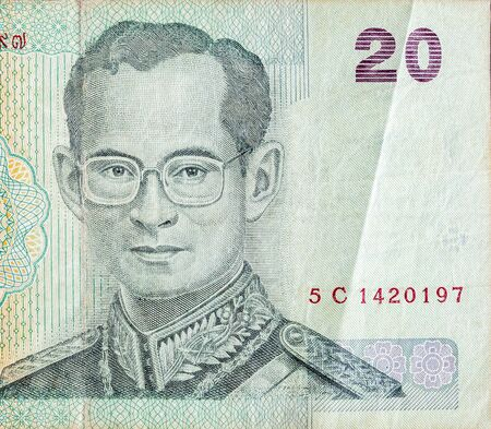 King Bhumibol Adulyadej on 20 Baht Thailand money bill close up. Bill of national currency of Thailand