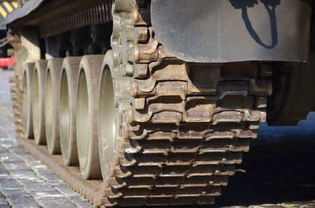Close up view of green armoured caterpillar transport. Modern military transportation vehicle technologies