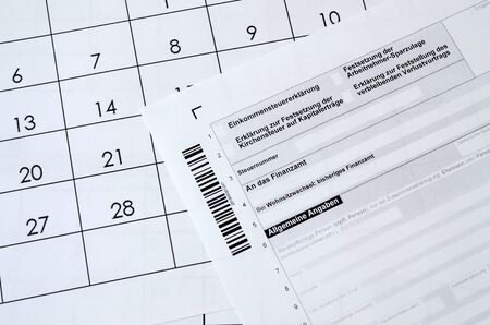 German tax form lies on office calendar. Concept of annual tax paying in Germany