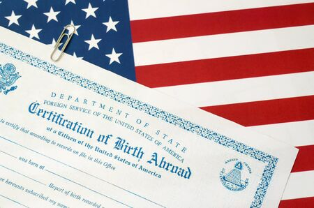 Fs-545 Certification of birth abroad lies on United States flag from US Foreign service close up Banco de Imagens