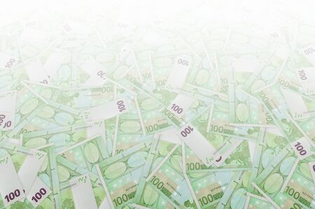 Front part of 100 euro banknote close-up with small green details. European currency bill