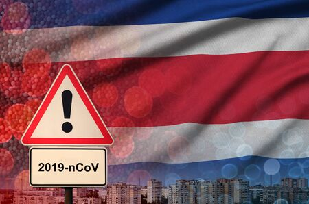 Costa Rica flag and virus 2019-nCoV alert sign. Concept of high probability of novel virus outbreak through traveling Chinese tourists Фото со стока