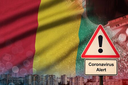 Guinea flag and virus 2019-nCoV alert sign. Concept of high probability of novel virus outbreak through traveling Chinese tourists Stock fotó