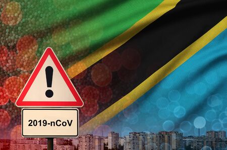 Tanzania flag and virus 2019-nCoV alert sign. Concept of high probability of novel virus outbreak through traveling Chinese tourists