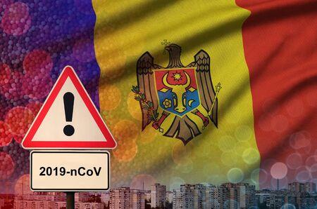 Moldova flag and virus 2019-nCoV alert sign. Фото со стока