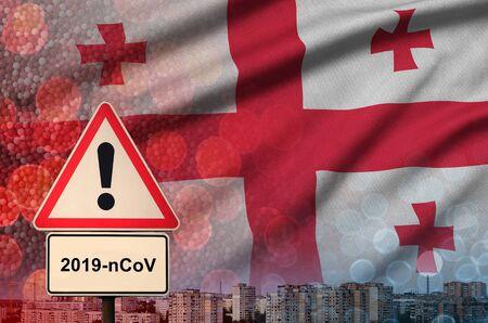 Georgia flag and virus 2019-nCoV alert sign. Фото со стока