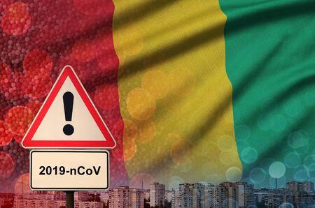 Guinea flag and virus 2019-nCoV alert sign.