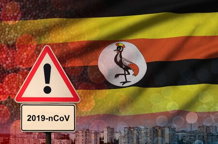 Uganda flag and virus 2019-nCoV alert sign.