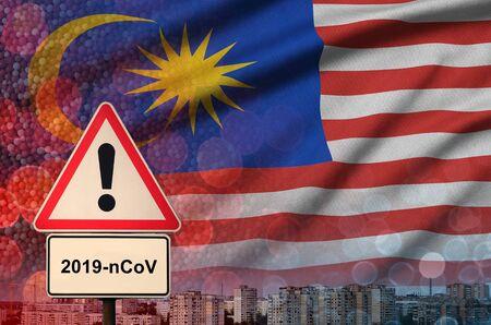 Malaysia flag and virus 2019-nCoV alert sign.