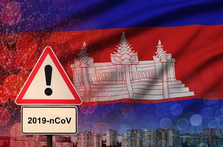 Cambodia flag and virus 2019-nCoV alert sign.